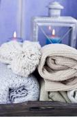 Warm scarfs with candles, selective focus — Stock Photo