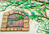 Low relief cement of tree on wall. — Stock Photo