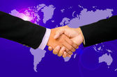 Hand shake between a businessman and a businesswoman. — Stock Photo