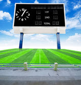 Old black score board in field soccer with blue sky. — Stock Photo