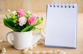 Focus at flower with blank diary binde — Stock Photo