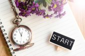 Start in black wooden tag and pocket watch at 1 pm. — Stock Photo
