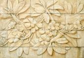 Low relief cement Thai style handcraft of plumeria or frangipani — Stock Photo