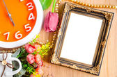 Flowers vase and vintage white picture frame. — Stock Photo