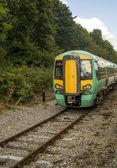 Fast train on rail tracks. — Stock Photo