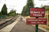 Warning sign on train station — Stock Photo
