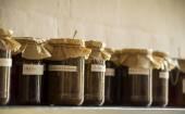 Glass jars on a shelf — Stockfoto