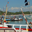 Fishers boats in the tropical harbour by the sea — Stock Photo #70578041