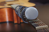 Microphone attached to the guitar neck. — Stock Photo