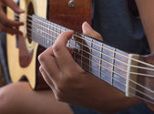 Playing on the guitar, closup. — Stock Photo