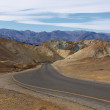 Curved aspalted road in heart of Death Valley — Stock Photo #64111309
