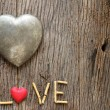 Word love with red and metal heart shaped valentines day — Stock Photo #56207971