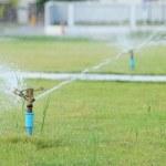 Water sprinkler spray watering in park. — Stock Photo #56209633