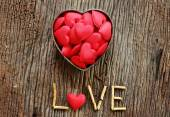 Word love with red and metal heart shaped valentines day — Stock Photo