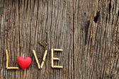 Word love with red heart shaped valentines day — Stock Photo