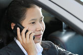 Business woman driving car and talking a telephone — Stock Photo