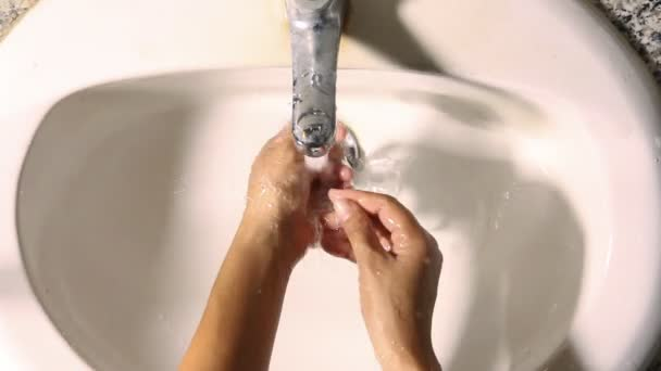 Woman washing, cleaning hand by water from trap in sink lavatory. — Vidéo