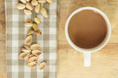 Coffee with nut on wood background — Stock Photo