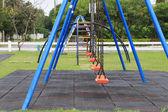 chain swings on kids playground — Stock Photo