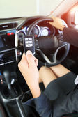 Business woman show remote key in modern vehicle car. — 图库照片