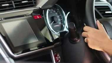 Business woman push start button in modern car for starting the engine. — Stock Video