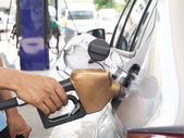 Male hand refilling fuel to car on a gas filling station — Stock Photo