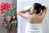 Asian Thai woman in spa salon lying on the massage desk. — Stock Photo