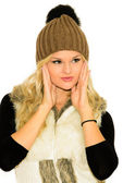 Young blond woman in a cap and vest — 图库照片