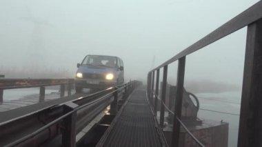 The car rides on pontoon bridge on river, winter — Stock Video