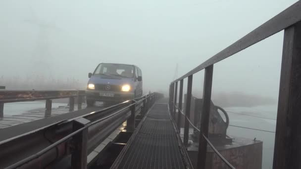 The car rides on pontoon bridge on river, winter — Vídeo de stock