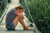 Portrait of a sad girl on the bridge — Stock Photo