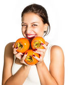Woman who very fond persimmon! — Stock Photo