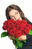 Portrait of a beautiful girl with a bouquet of roses — Stock Photo