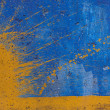 Yellow spray on blue painted wall — Stock Photo #57487977