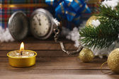 Antique clocks, spruce branch, candle, Christmas decorations  — Stock Photo