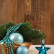Christmas tree ornaments balls, beads and spruce branch in a bas — Stock Photo #58677231