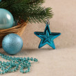Christmas tree ornaments balls, beads and spruce branch in a bas — Stock Photo #58677235