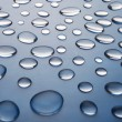 Drops of water on a dark blue gradient background — Stock Photo #67846193