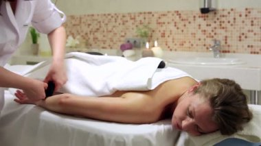 Woman Enjoying Stone Therapy. Female Receiving a Relaxing Massage Treatment — Stock Video