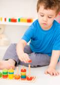 Boy is playing with building blocks — Stock Photo