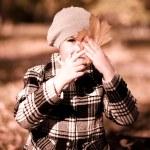 Portrait of a little girl in autumn park — Stock Photo #54951725
