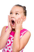 Cute girl is holding her face in astonishment — Stock Photo