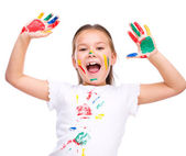 Милая девушка, игра с красками — Стоковое фото
