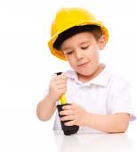 Boy as a construction worker with tape measure — Stock Photo