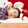 Cute boy daydreaming lying on the floor. New Year — Stock Photo #59468439