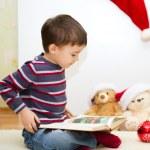 Cute boy reading a fairy tale. New Year — Stock Photo #59468485