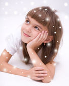 Cute girl is daydreaming — Stock Photo