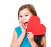 Happiness - smiling girl with red heart — ストック写真