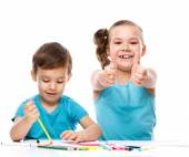Cute children is drawing on white paper — Stock Photo