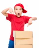 Happy girl holding cardboard boxes — Stock Photo